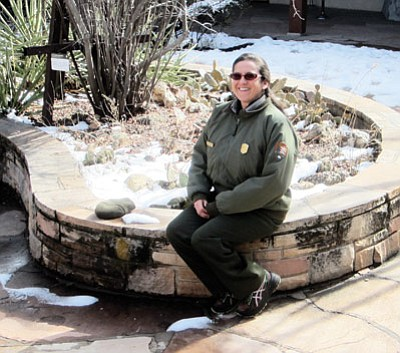Interpretive Ranger Graciela Avila creates booklets for the junior ranger program at Grand Canyon National Park. Loretta Yerian/WGCN