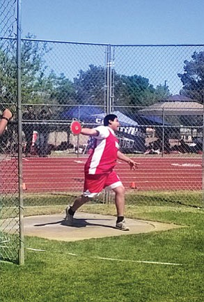 Neegho Kaska hurls a discus 78.6 meters. Photos/Monica Nanacasia