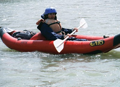 Grand Canyon School student Cale Wisher in a duckie during the annual Grand Canyon Youth river trip April 15 - 18. Photo/Lori Rommel