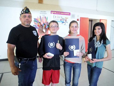 American Legion John Ivens Post No. 42 member Ben Gomez honoring the highest GPA female and male eighth grade students, Nolan Johnson, Emma Perkins and Meaghan Donehoo.<br /><br /><!-- 1upcrlf2 -->Photos/Lori Rommel