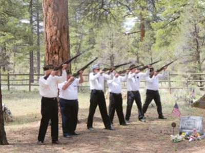 From left, American Legion Post 42 Honor Guard, Al Richmond, Ed Rocha, Bob Blasi, Al Dunaway, John Miller and Mike Rioux perform a rifle salute at the Memorial Day service at Grand Canyon's Pioneer Cemetery May 25.  Photo/Scott Miller