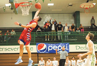 Grand Canyon School senior Tyler Jones makes a slam dunk during the 2014 Pepsi Tournament. Loretta Yerian/WGCN