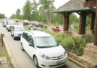 Wait time at entrance fee stations into Grand Canyon National Park can last 30 minutes or more. File photo