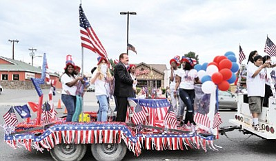 A red, white and blue float passes down Main Street in Tusayan for the Fourth of July parade. Photo/Yvonne Trujillo