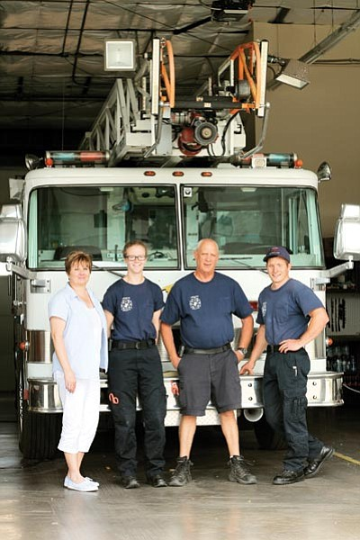 Tusayan Fire Chief Robbie Evans will spend his last month training Greg Brush as his replacement.  Left to right: Chrystal Shoppmann, Anja Curwen, Robbie Evans and Tyler Krombeen. Loretta Yerian/WGCN