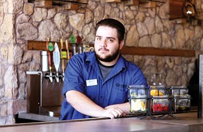 Christopher Sawyer bartends at the new Yavapai Tavern. Loretta Yeiran/WGCN