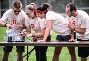 Xanterra retail department's Seth Fuhrman, Paula Ackland-Coletta, Maddie Williams and Jonah Mohr give it all they have in the Four–Stooges Relay.  The retail department placed first. Photo/Ronnie Tierney, Fresh Focuses Photography