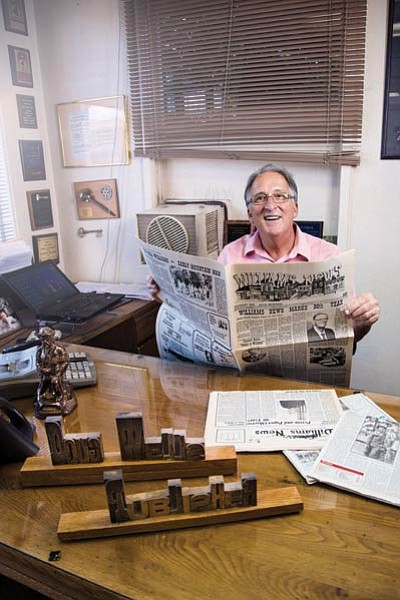 Williams-Grand Canyon News Publisher Doug Wells looks through some old editions of the paper. Ryan Williams/WGCN