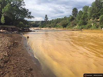 The Animas River runs yellow with toxin-tainted wastewater that was accidentally released from the abanoned Gold King Mine near Durango, Colorado. Photo/Colorado Parks and Wildlife Department via Reuters