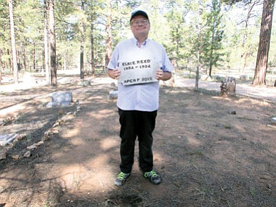 Parker Anderson prepares to place Elsie Reed's tombstone. Photo/David Schmittinger<br /><br /><!-- 1upcrlf2 --><br /><br /><!-- 1upcrlf2 -->