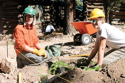 """Grand Canyon National Park Vegetation Crew Coordinator Sarah Sterner shows volunteer Theodore """"Ted"""" Buxton planting techniques at the North Rim re-vegetation project. Loretta Yerian/WGCN"""