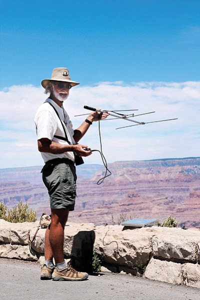 Bob George a volunteer with Grand Canyon National Park's Wildlife Program tracks California Condors with a Yagi antenna.  Loretta Yerian/WGCN
