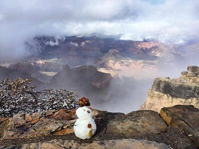 The first snowman of the season gets an up close view of the Canyon after the season's first snow storm Nov. 4. Erin Whittaker/NPS