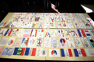 Students in third through 12th grade designed and colored sympathy cards to be sent to the U.S. Embassy in France after the capital was attcked Nov. 13. Loretta Yerian/WGCN