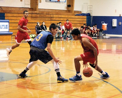 Nick Gomez dribbles the ball away from his opponent.   Loretta Yerian/WGCN