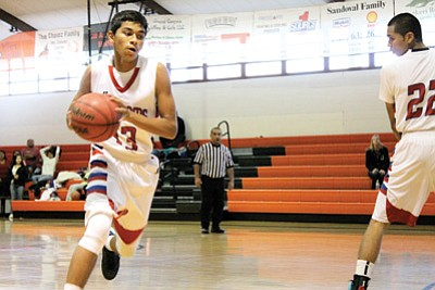 Nick Gomez takes the ball down the court during the tournament Dec. 5. Loretta Yerian/WGCN