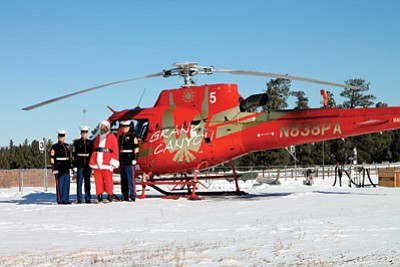 Marines with Toys for Tots and Santa prepare to fly into Supai Village from Tusayan Dec. 16. Loretta Yerian/WGCN