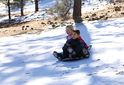 Gavin Dorse and Marley Wadlington from San Diego, California, enjoy a run down the Oak Hill Snow Play area in Williams. Ryan Williams/WGCN