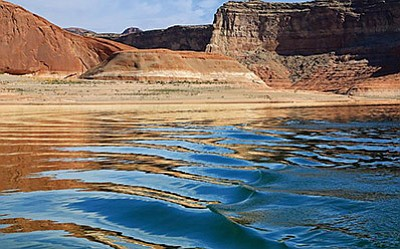 Ripples in the Lake Powell reflect the sandstone cliffs. Photo/Bob Moffitt, NPS