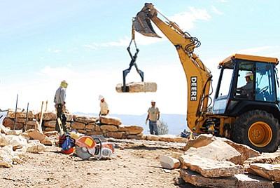 Crews repair a wall in the Grand Canyon National Park in this 2012 file photo. A new National Park Service report says the nation's parks had $11.9 billion in deferred maintenance last year, including a $371 million backlog at the Grand Canyon. Photo/Kristen M. Caldon/NPS