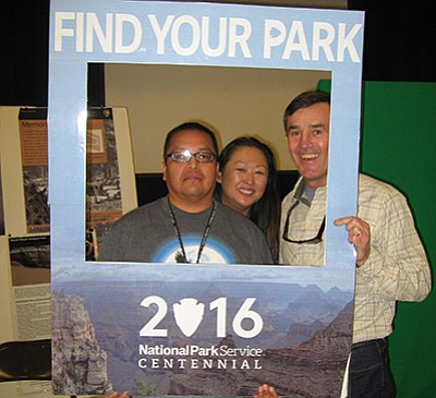 Grand Canyon National Park Superintendent Dave Uberuaga, Grand Canyon Public Affairs specialist Kirby, and Charley Bulletts enjoy the 'Find Your Park' booth at the Winter Carnival. Photo/NPS