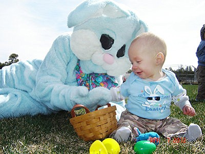 In 2012 Kaylith Parent visits with the Easter Bunny and enjoys his first Easter. Photo/Clarinda Vail