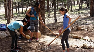 Students prepare the restoration site at Grand Canyon School for planting. Photo/Tyra Briones