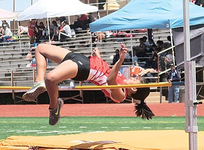 Jessica Richardson competes in the high jump during the Winslow meet. Photo/Kim Besom