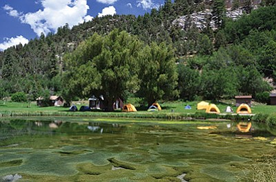 Reflections of tents at the Big Springs restoration site. Photo/USFS,Southwestern Region, Kaibab National Forest