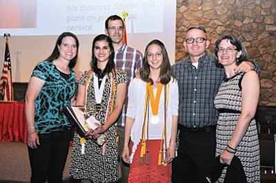 Elna and David Perkins with daughter Ellie Perkins (GCS Valedictorian) and GCS Salutatorian Kylie Donehoo with parents Brian and Betsy Donehoo. Photo/Cyndi Moreno