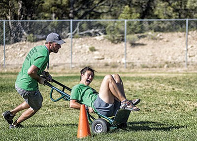 Employees in a hand cart during the Running the Gauntlet in the 2016 Xanterra employees Olympics. Photo/Ronnie Tierney - Fresh Focuses Photography