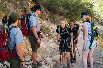 Grand Canyon PSAR rangers Ashley Butts and Josh Weiner talk to hikers on the Bright Angel Trail Aug. 12. Loretta Yerian/WGCN