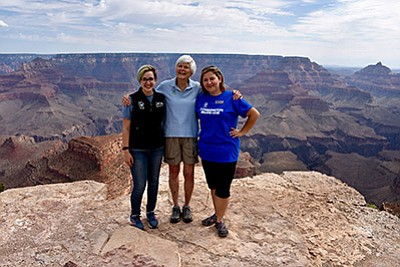 """Elizabeth """"Liz"""" Putnam, founding president of the Student Conservation Association stops at Shoshoni Point and visits with Jamie Rosenberg (left) and Sarah Lechich, NPS Centennial Volunteer Ambassadors. Submitted photos"""