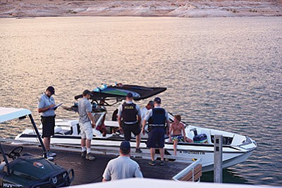 Interagency officers perform an Operating Under the Influence and safety check on a boat at the Antelope Point Marina Aug. 13. Photo/courtesy of Coconino County Sheriff's Office