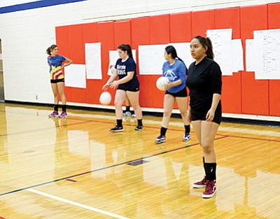 Grand Canyon High School Lady Phantoms soak in head coach Gretchen Bilton's serving lessons at practice. Loretta Yerian/ WGCN