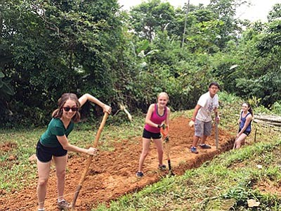 Kyla Pearce (center) and fellow volunteers dig a trench for bathroom piping in the village of La Alfombra in Costa Rica. Photo/courtesy of Kyla Pearce
