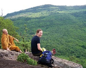 Middle school science teacher Jesse Smith enjoys the view with a Buddhist monk. In Thailand, monks take on much of the responsibility for conservation and sustainability, seeing it as consistent with their beliefs, Smith said.
