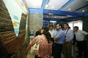 Grand Canyon Superintendent Steve Martin joins tourists in viewing an exhibit on rock strata at Yuntaishan World Geopark. Strata exposed by river erosion is one of the features shared with Grand Canyon National Park with whom the China park signed a sister park agreement last month.