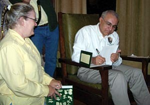 """Costa Dillon, who today leaves his position as superintendent of the Horace Albright Training Center to become superintendent of Indiana Dunes National Lakeshore, signs autographs at a reading he gave from the new book, """"Oh, Ranger!"""" published by the American Park Network. Dillon contributed a chapter, """"The Last Walk,"""" to the book and presented it in an emotional reading at Kolb Studio last Thursday. The book is available at GCA bookstores throughout the park."""