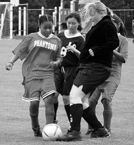 Tatyonna Jeter plays soccer last Saturday against Seligman.