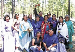 The Hualapai Ethnobotany Project students and staff: Lucille Watahomigie, Phyna Cook, Adina Hunter, Carrie Cannon, Cheyenne Majesty, Dennis Sullivan, Christina Watahomigie, Frank Mapatis, Veronica Lewis, Amy Vaughn, Malinda Powskey, Nikki Poleahla and Colleen Mack. Other staff and students involved but not present in the photo include Delores Honga, Vera Watahoname, Cheryle Beecher, Andrea Zephier, Georgetta Russel, Consuela Bravo and Majenta Powskey. At top: Informational cards.