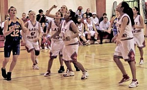 The Lady Phantoms wait for a rebound at last Saturday's home game with Joseph City.