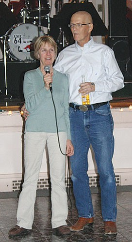"Peggy and Marcus Fuhrman speak at a fundraising dance that was one stop on what he called his ""Tom Sawyer Farewell."""