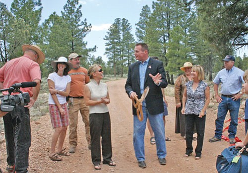 Former U.S. Rep. J.D. Hayworth shares a celebratory moment with School Board President Clarinda Vail and other key players during a ribbon cutting ceremony at the new school property off Long Jim Loop in Tusayan. The Grand Canyon Unified School District was able to purchase the land under legislation that Hayworth sponsored.
