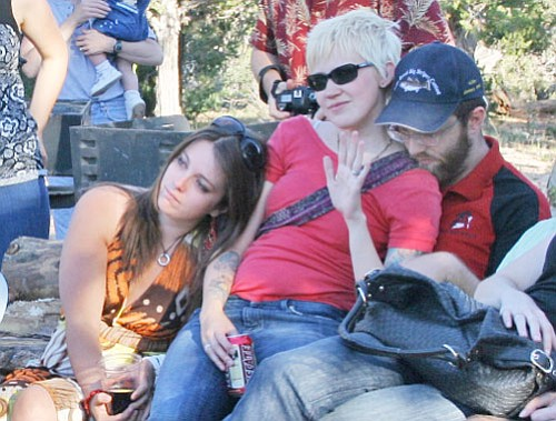 Marcus Fuhrman's children – daughter Mandy, daughter-in-law Alena and son Wes, listen to friends and family as they share their memories at a gathering at Shoshone Point last Wednesday.