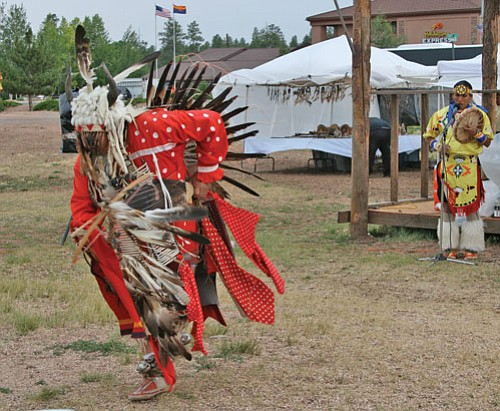 David Brush performs the traditional eagle dance with Tony Duncan accompanying on drum.