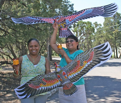 Melanie Fellows and Leona Begishie show off new Chinese-made kites being offered at Grand Canyon Association bookstores.