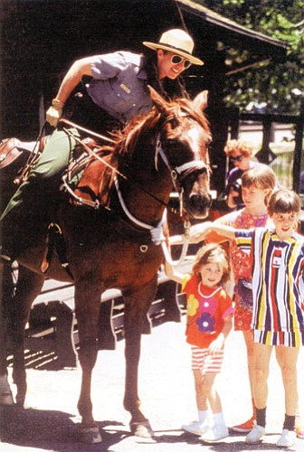 Nancy Muleady-Mecham meets with visitors while on horse patrol