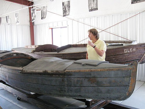 Jackie Brown/GCN Director of Cultural Resources Jan Balsom talks about the park's historic boats in a tour for the Grand Canyon Historical Society.