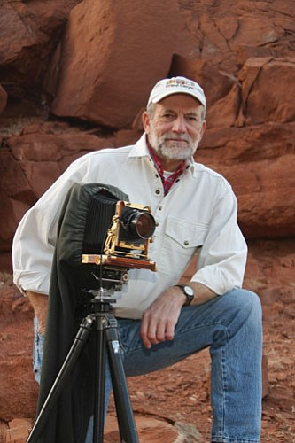 Author Gary Ladd poses with his camera. Ladd has more than 30,000 images of the Canyon cataloged and captioned.